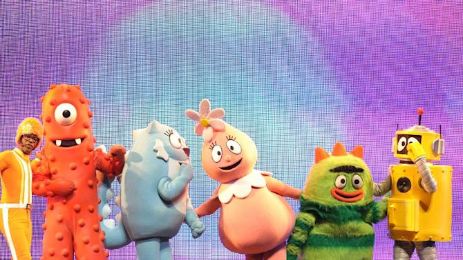 From left, DJ Lance Rock, Muno, Toodee, Foofa, Brobee and Plex perform onstage at Yo Gabba Gabba! Live!: Get The Sillies Out! 50+ city tour kick-off performance on Thanksgiving weekend at Nokia Theatre L.A. Live on Friday Nov. 23, 2012 in Los Angeles. (Photo by John Shearer/Invision for GabbaCaDabra, LLC./AP Images)