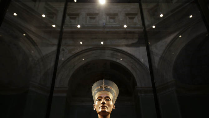 The Nefertiti bust is pictured during a press preview of the exhibition 'In The Light Of Amarna' at the Neues Museum in Berlin, Germany, Wednesday, Dec. 5, 2012 due to the 100th anniversay of the discovery of the bust of the Nefertiti. (AP Photo/Michael Sohn, pool)