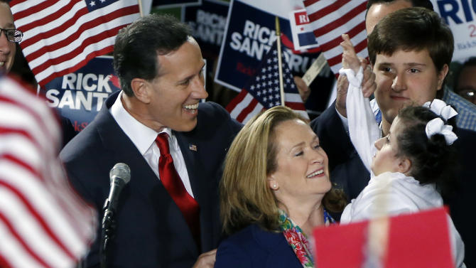 Former U.S. Sen. Rick Santorum, left, and his wife Karen, center, talk with his daughter Bella, right, as he announces his candidacy for the Republican nomination for President of the United States in the 2016 election on Wednesday, May 27, 2015 in Cabot, Pa. (AP Photo/Keith Srakocic)