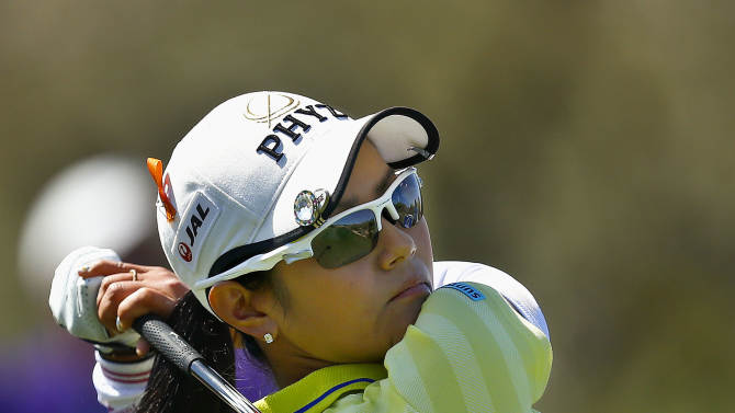 Ai Miyazato, of Japan, hits her tee shot on the third hole during the final round of the LPGA Founders Cup golf tournament on Sunday, March 17, 2013, in Phoenix. (AP Photo/Ross D. Franklin)