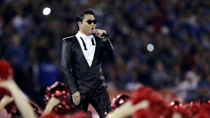 South Korean entertainer Psy performs during halftime of an NFL football game between the Buffalo Bills and Seattle Seahawks, Sunday, Dec. 16, 2012, in Toronto. (AP Photo/Mike Groll)