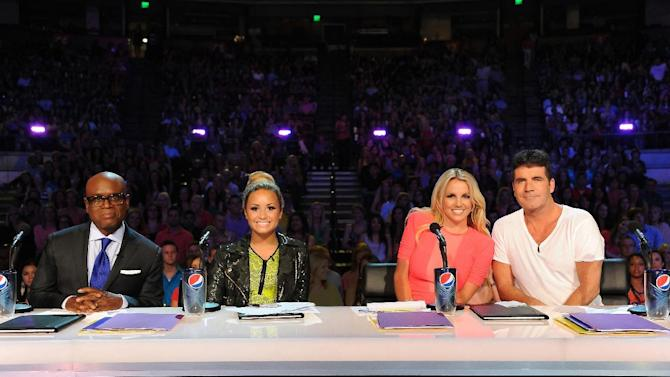 """This May 24, 2012 photo released by Fox shows judges, from left, L.A. Reid, Demi Lovato, Britney Spears and Simon Cowell from the singing competition series, """"The X Factor,"""" in Austin, Texas. (AP Photo/Fox, Ray Mickshaw)"""