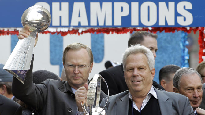 New York Giants co-owners John Mara, left, holding the Vince Lombardi Trophy, and Steve Tisch, holding the Halas Trophy, during the team's NFL football Super Bowl parade in New York, Tuesday, Feb. 7, 2012. The Giants beat the New England Patriots 21-17 on Sunday in Indianapolis. (AP Photo/Julio Cortez)