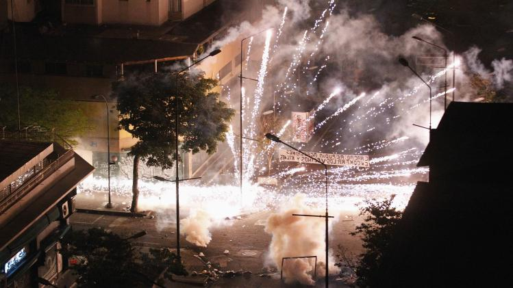 Anti-government protesters shoot firecrackers at national police at the Chacao borough in Caracas