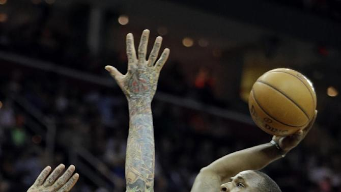 Cleveland Cavaliers' Dion Waiters (3) goes in for a dunk over Miami Heat's Chris Andersen (11) in the second quarter of an NBA basketball game Monday, April 15, 2013, in Cleveland. (AP Photo/Mark Duncan)