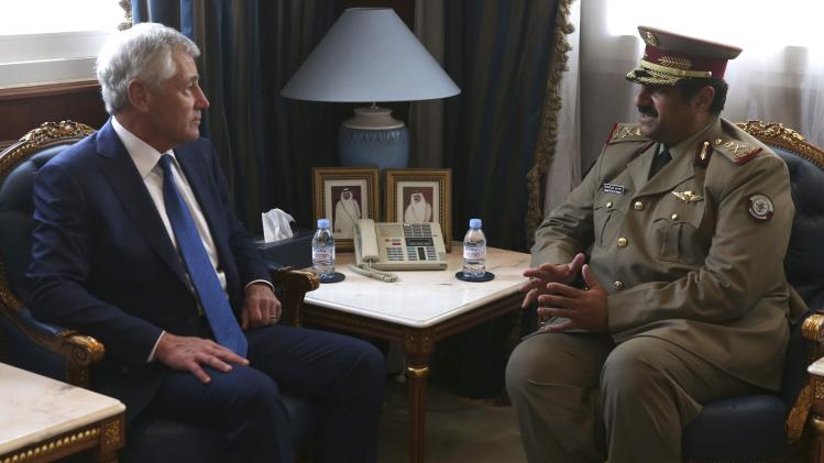 U.S. Secretary of Defense Hagel meets with Qatar's Defence Minister al-Attiyah at the Defence Headquarters in Doha