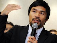 Philippine boxing icon Manny Pacquiao, pictured in March 2012. A row sparked by Pacquiao's comments on gay marriage has damaged the world champion, but has not so far affected any of his mega-buck endorsement deals, his spokeswoman said Friday