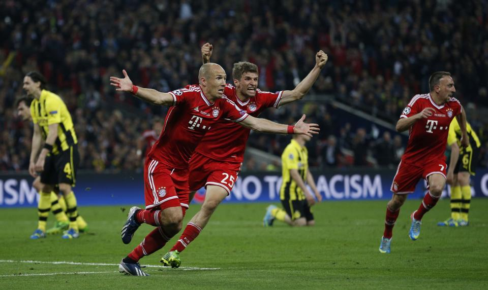 Bayern's Arjen Robben of the Netherlands, center left, celebrates scoring the winning goal, during the Champions League Final soccer match between Borussia Dortmund and Bayern Munich at Wembley Stadium in London, Saturday May 25, 2013.  (AP Photo/Matt Dunham)