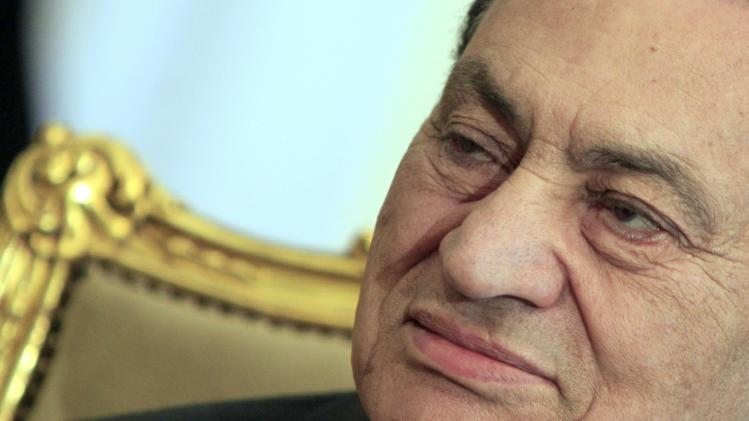 FILE - In this Tuesday, Feb. 8, 2011 file photo, the Egyptian President Hosni Mubarak sits during his meeting with Emirates foreign minister, not pictured, at the Presidential palace in Cairo, Egypt. Egypt's state news agency, MENA, announced Sunday that the retrial of ousted President Hosni Mubarak on charges related to the killings of protesters during the uprising against him will begin April 13. MENA said Sunday six security officials will also be tried and that Mubarak's two sons and a business associate will be retried on corruption charges. (AP Photo/Amr Nabil, File)
