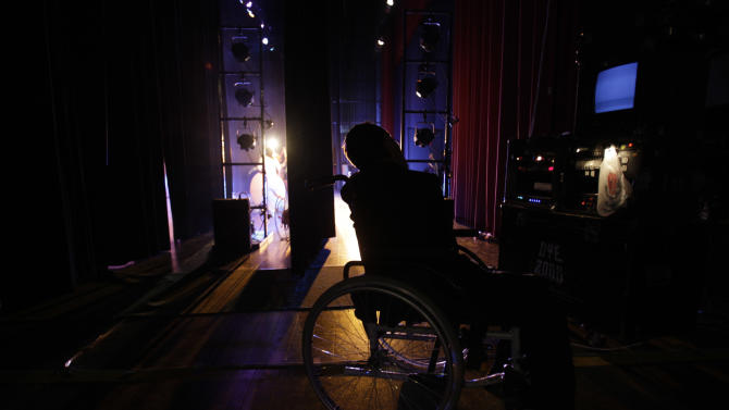 """In this Sept. 21, 2012 photo, actor Juan Fernando waits backstage before his performance in """"Suenos,"""" or """"Dreams,"""" one of Ecuador's most successful musicals, at the Casa de la Cultura theater in Quito, Ecuador. The musical is based in part on the dreams of young people with disabilities and is presented by the nonprofit foundation El Triangulo. (AP Photo/Dolores Ochoa)"""