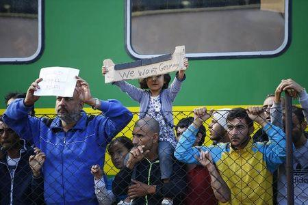 """Migrants hold out on Hungarian """"freedom train""""; Orban says millions coming"""