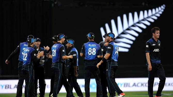 New Zealand celebrate after the third one-day international cricket match against Australia