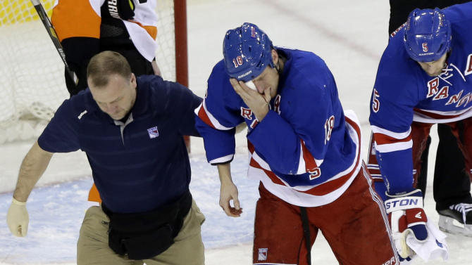 New York Rangers' Marc Staal is helped by a trainer after being injured during the third period of an NHL hockey game against the Philadelphia Flyers on Tuesday, March 5, 2013, in New York. The Rangers won the game 4-2.  (AP Photo/Frank Franklin II)