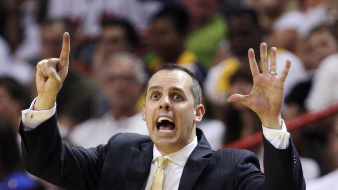 Indiana Pacers head coach Frank Vogel calls out a play during the second half of Game 1 in an NBA basketball Eastern Conference semifinal playoff series against the Miami Heat, Sunday, April 13, 2012, in Miami. The Heat won 95-86. (AP Photo/Wilfredo Lee)