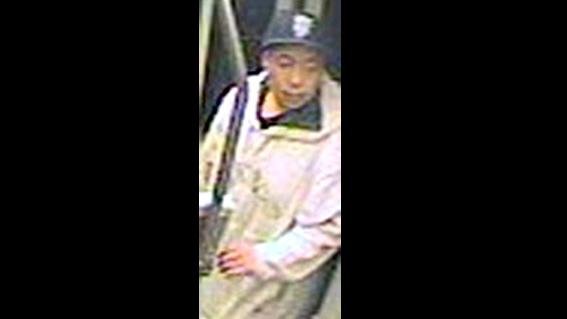 This Sept. 23, 2013 image taken from a surveillance video and provided by the San Francisco Police Department show suspect Nikhom Thephakaysone on a MUNI train in San Francisco. Authorities in San Francisco say Thephakaysone, the suspect in the alleged random slaying of a university student flashed a gun several times on a crowded train before the attack, but the passengers were so absorbed in personal hand-held devices they didn't notice until he randomly shot a university student. (AP Photo/San Francisco Police Department)