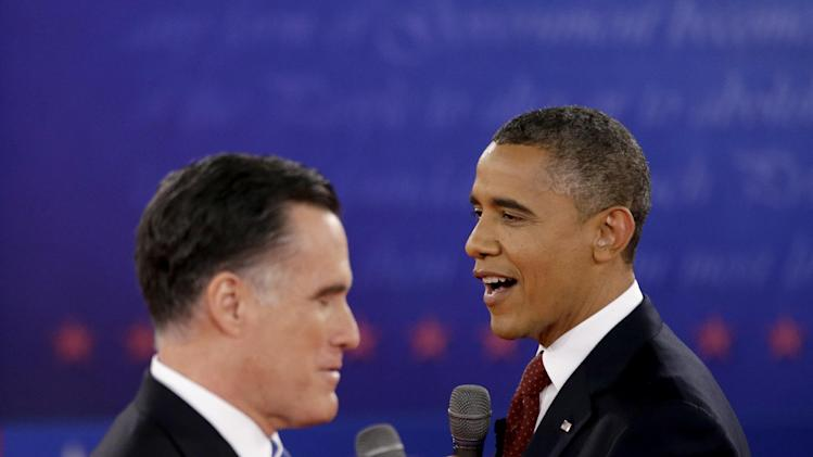FILE - In this Oct. 18, 2012 file photo, President Barack Obama, right, and Republican presidential candidate, former Massachusetts Gov. Mitt Romney exchange views during the second presidential debate at Hofstra University in Hempstead, N.Y. The binders are long gone, but Mitt Romney's awkward phrase is likely to endure at least a little longer.  The GOP nominee was trying to convey his commitment to hiring women when he spoke during one of the debates about demanding more potential job applicants when he was Massachusetts governor. (AP Photo/David Goldman, File)