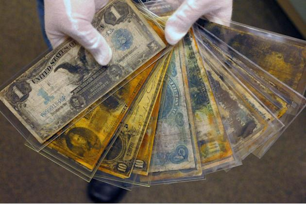 FILE - In a Friday, Aug 15, 2008 file photo, currency, part of the artifacts collection of the Titanic, is shown at a warehouse in Atlanta. The owner of the largest trove of artifacts salvaged from th