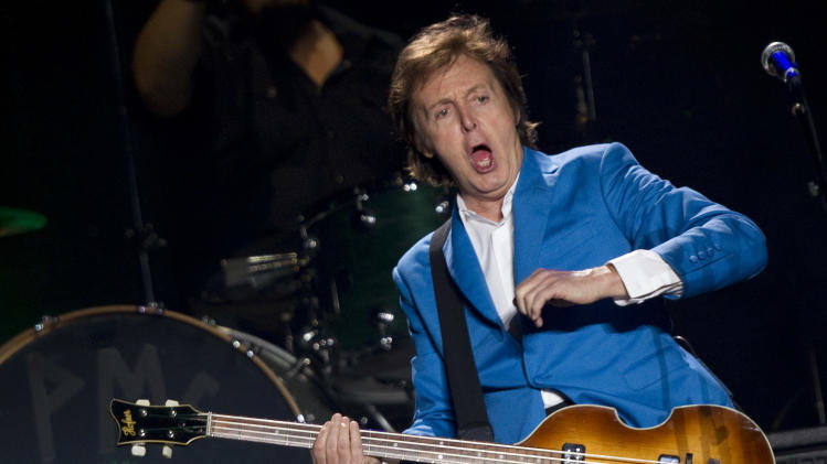 """FILE - In this Sunday, Nov. 21, 2010 file photo, British musician Paul McCartney performs during his """"Up And Coming Tour"""" at the Morumbi Stadium in Sao Paulo. McCartney is kicking off the North American leg of his """"Out There"""" tour in Orlando, Fla., on Saturday, May 18, 2013. The massive production, which requires 31 trucks worth of equipment, includes lasers, huge pyrotechnics, and state of the art video displays, according to the website of the former Beatles star. (AP Photo/Andre Penner, File)"""