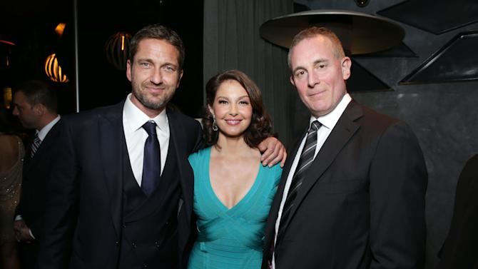 Gerard Butler, Ashley Judd and Executive Producer/FilmDistrict's Peter Schlessel at FilmDistrict's Premiere of 'Olympus Has Fallen' hosted by Brioni and Grey Goose at the ArcLight Hollywood, on Monday, March, 18, 2013 in Los Angeles. (Photo by Eric Charbonneau/Invision for FilmDistrict/AP Images)
