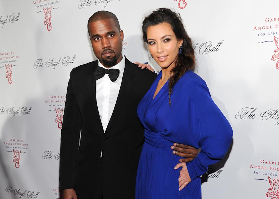 FILE - In this Oct. 22, 2012 file photo, singer Kanye West and girlfriend Kim Kardashian attend a benefit in New York. Reports attributed to anonymous sources broke over the weekend that Kardashian has given birth to her baby with West. (Photo by Evan Agostini/Invision/AP, File)