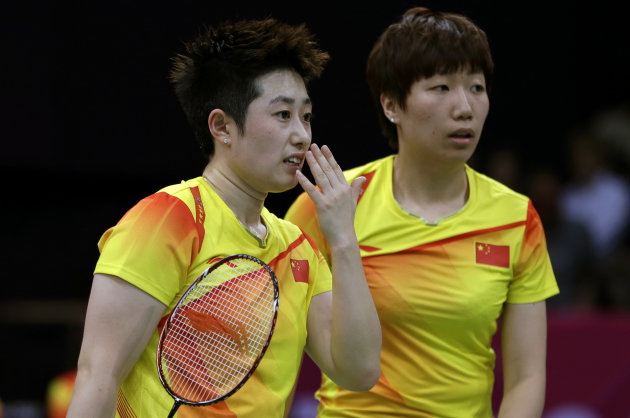 China&#39;s Yu Yang, left, and Wang Xiaoli talk while playing against Jung Kyun-eun and Kim Ha-na, of South Korea, in a women&#39;s doubles badminton match at the 2012 Summer Olympics, Tuesday, July 31, 2012, in London. World doubles champions Wang and Yu, and their South Korean opponents were booed loudly at the Olympics on Tuesday for appearing to try and lose their group match to earn an easier draw. (AP Photo/Andres Leighton)