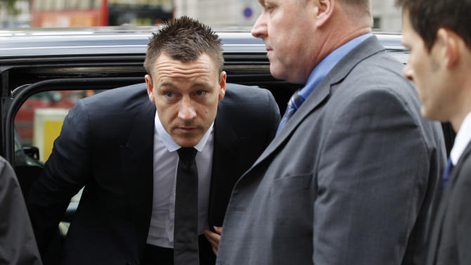 "Former England soccer captain and Chelsea player John Terry, center, arrives at Westminster Magistrates Courts in London, Tuesday, July 10, 2012. The racism trial of Terry began Monday with prosecutors claiming the Chelsea captain acknowledges using offensive language as a ""sarcastic exclamation"" in response to taunts that he allegedly had an affair. The England defender is accused of racially abusing Queens Park Rangers defender Anton Ferdinand, who is black, during a Premier League match in October.  (AP Photo/Sang Tan)"
