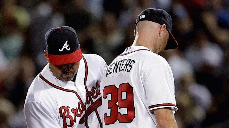 Atlanta Braves relief pitcher Jonny Venters, right, is sent to the dugout by manager Fredi Gonzalez after giving up a grand slam to New York Yankees' Alex Rodriguez in the eighth inning of a baseball game Tuesday, June 12, 2012, in Atlanta. (AP Photo/David Goldman)