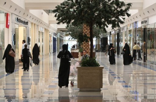 Women walk through a shopping mall in the Saudi capital of Riyadh.