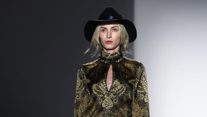 The Rachel Zoe Fall 2013 collection is modeled during Fashion Week in New York, Wednesday, Feb. 13, 2013. (AP Photo/Richard Drew)