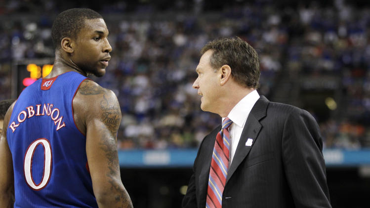 Kansas head coach Bill Self talks with forward Thomas Robinson, left, during the first half of the NCAA Final Four tournament college basketball championship game against Kentucky Monday, April 2, 2012, in New Orleans. (AP Photo/Mark Humphrey)