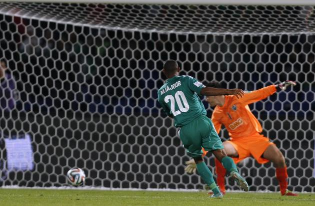 Raja Casablanca's Iajour scores a goal against Atletico Mineiro's during their FIFA Club World Cup semi-final soccer match at Marrakech stadium
