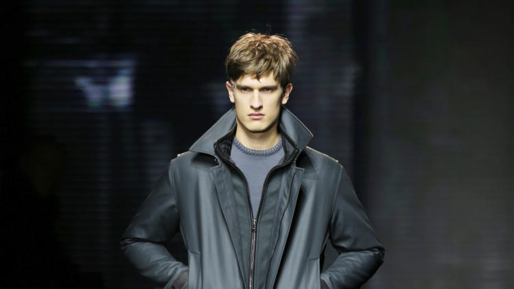 A model wears a creation for Salvatore Ferragamo men's Fall-Winter 2013-14 collection, part of the Milan Fashion Week, unveiled in Milan, Italy, Sunday, Jan. 13, 2013. (AP Photo/Antonio Calanni)