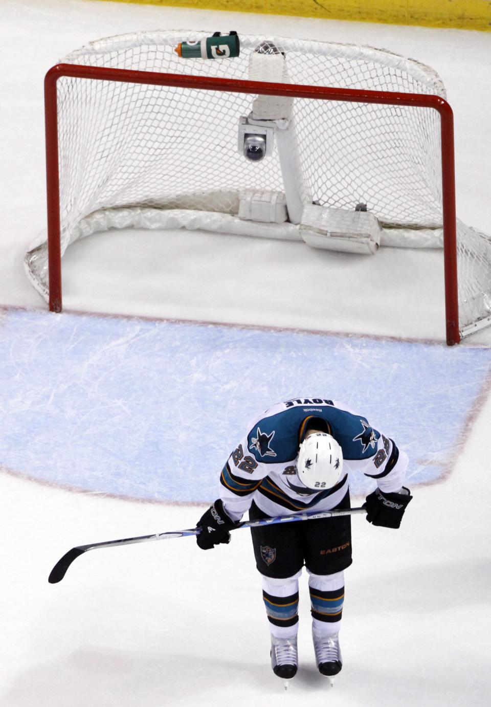 San Jose Sharks' Dan Boyle reacts as the final horn sounds on their 3-1 loss to the St. Louis Blues in Game 5 of an NHL Stanley Cup first-round hockey playoff series, Saturday, April 21, 2012, in St. Louis. The Blues won series 4-1. (AP Photo/Jeff Roberson)