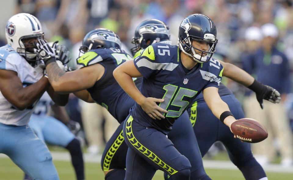 Seattle Seahawks quarterback Matt Flynn looks to hand off during the first half of an NFL football preseason game against the Tennessee Titans, Saturday, Aug. 11, 2012, in Seattle. (AP Photo/Rick Bowmer)