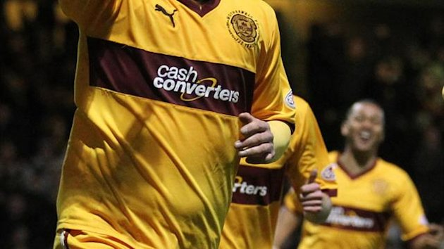 Michael Higdon scored either side of the break in a convincing Motherwell win