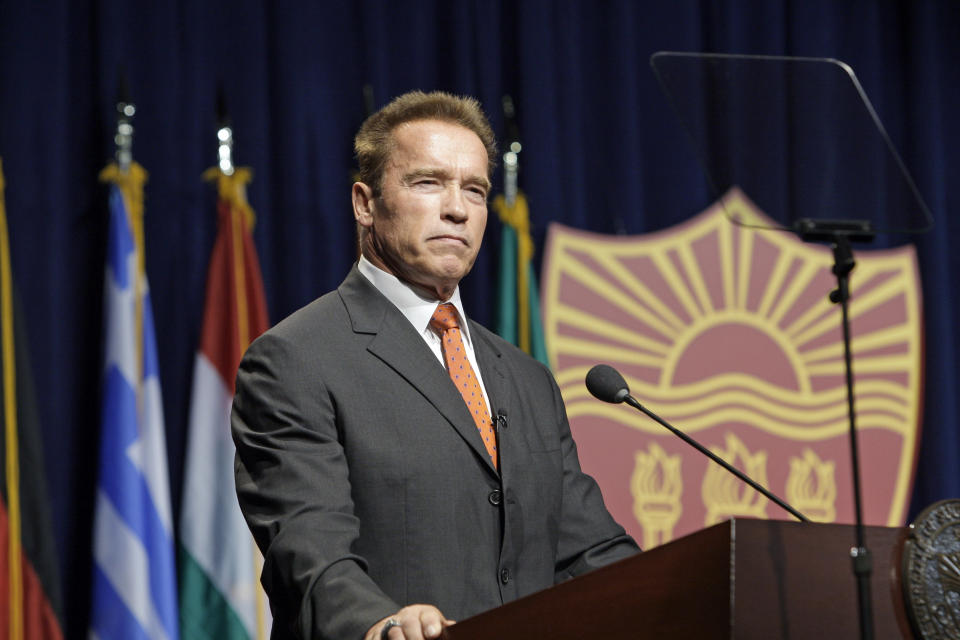 Former California Gov. Arnold Schwarzenegger delivers the keynote address at the inaugural symposium sponsored by the Schwarzenegger Institute for State and Global Policy, at the University of Southern California in Los Angeles Monday, Sept. 24, 2012. (AP Photo/Reed Saxon)