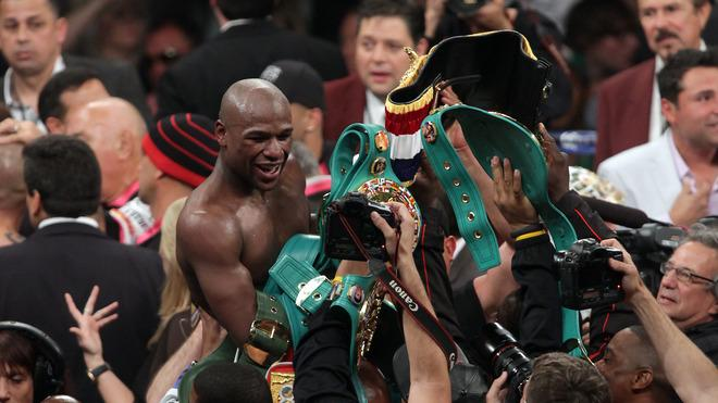 Floyd Mayweather Jr. Celebrates AFP/Getty Images