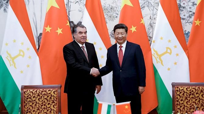 Chinese President Xi shakes hands with Tajikistan President Rahmon during a signing ceremony in Beijing