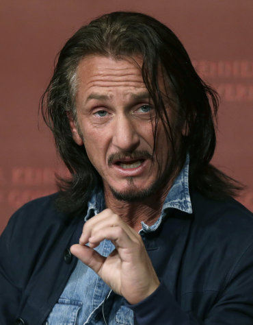 Actor-director Sean Penn gestures as he participates in a discussion at Harvard University's John F. Kennedy School of Government in Cambridge, Mass. Tuesday, Feb. 26, 2013 regarding Haiti in the wake of a devastating earthquake three years ago. Penn is the co-founder of the J/P Haitian Relief Organization. (AP Photo/Elise Amendola)
