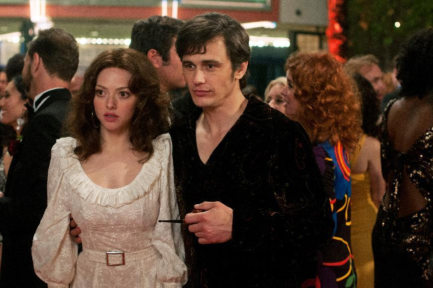 "This film publicity image released by RADIUS-TWC shows Amanda Seyfried as Linda Lovelace, left, and James Franco as Hugh Hefner in ""Lovelace."" (AP Photo/RADIUS-TWC, Dale Robinette)"