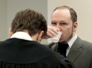 "Mass killer Anders Behring Breivik drinks a glass of water in the courtroom in Oslo, Norway Thursday April 26, 2012. Breivik has slammed a psychiatric report that declared him insane, insisting it was based on ""evil fabrications"" meant to portray him as irrational and unintelligent. (AP Photo/Hakon Mosvold Larsen/NTB Scanpix, Pool)"