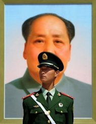 A Chinese policeman stands in front of a portrait of the late Chinese leader Mao Zedong at Baijing's Tiananmen Square in April 2012. Chinese authorities are seeking to whitewash the alleged crimes of fallen leader Bo Xilai and protect his political backers by shifting the blame on his wife who will be tried for murder, activists say
