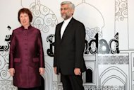 Iran's chief nuclear negotiator Saeed Jalili (R) poses with European Union's foreign policy chief Catherine Ashton before a meeting in the Iraqi capital Baghdad. World powers pressing Iran to scale back its nuclear programme Wednesday offered a new batch of incentives that fell short of the sanctions relief sought by Tehran, which made a counter-proposal