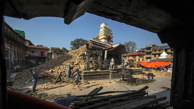Nepalese military personnel stands guard inside a compound of Bungamati temple after the earthquake at Bungamati Village, on the outskirts of Kathmandu