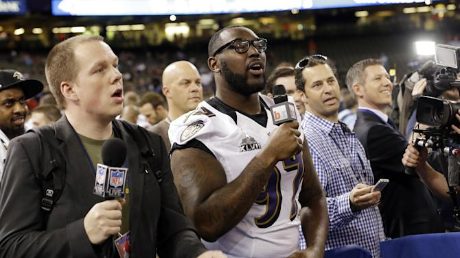 Baltimore Ravens defensive end Arthur Jones acts like a reporter during media day for the NFL Super Bowl XLVII football game Tuesday, Jan. 29, 2013, in New Orleans. (AP Photo/Pat Semansky)