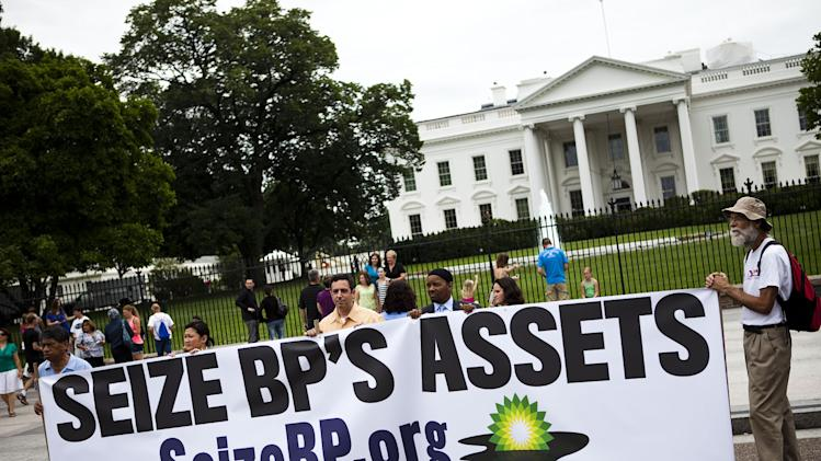"FILE- In this Tuesday, June 15, 2010, file photo, a group called ""Seize BP"" holds up an anti-BP sign in front of the White House, in Washington. The Obama administration put a temporary stop to new federal contracts with British oil company BP on Wednesday, Nov. 28, 2012, citing the company's ""lack of business integrity"" and criminal proceedings stemming from the Deepwater Horizon disaster in 2010. (AP Photo/Drew Angerer, File)"