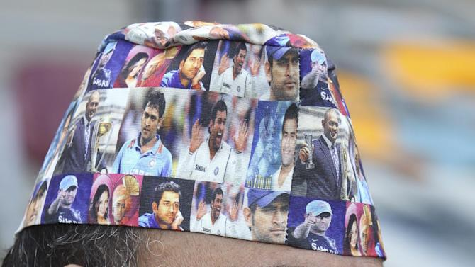 A Pakistani fan sports a cap with pictures of Indian captain M.S.Dhoni during the Pool B Cricket World Cup match between Pakistan and Zimbabwe in Brisbane, Australia, Sunday, March 1, 2015. (AP Photo/Tertius Pickard)