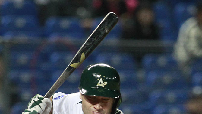 Australia's right fielder Tim Kennelly gets hit by a pitch from Korea during the second inning of their World Baseball Classic first round game at the Intercontinental Baseball Stadium in Taichung, Taiwan, Monday, March 4, 2013. (AP Photo/Wally Santana)
