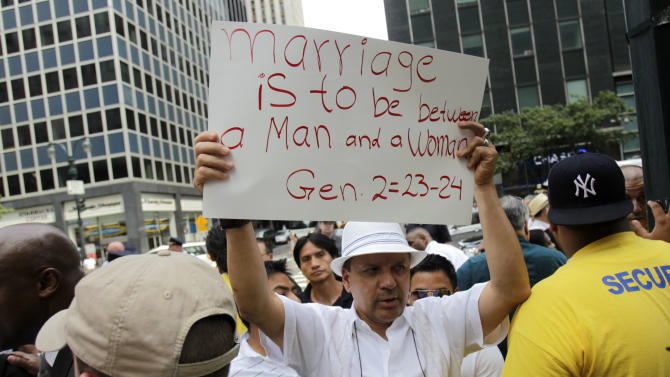 A man participates in a protest against gay marriage in front of New York Governor Andrew Cuomo's office in New York, Sunday, July 24, 2011. New York became the sixth and largest state to recognize same-sex weddings in a close state Senate vote on June 24 after strong lobbying by Cuomo and advocates. The first gay marriages in New York were performed just after midnight and continued through the day at municipal offices that opened for special weekend hours. (AP Photo/Seth Wenig)