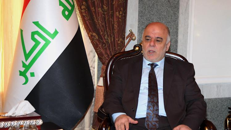 FILE - In this Thursday, Aug. 21, 2014 file photo, Iraqi premier-designate Haider al-Abadi, of the Shiite Islamic Dawa Party, meets with Pastor Farouk Yousuf in Baghdad, Iraq. Iraq's Sunni minority have felt maligned by the Shiite-led government in Baghdad, hounded by its security forces and increasingly threatened, once again, by the militias that terrorized them during the darkest days of sectarian bloodletting in 2006 and 2007. The community's anger has fueled the rampage of Islamic extremists across a third of the country, and Sunnis say their demands must be met by the new Shiite-led government if it hopes to be more inclusive. (AP Photo/Karim Kadim, File)